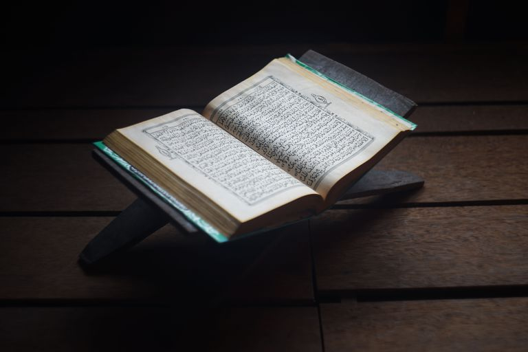 high-angle-view-of-koran-with-rehal-on-hardwood-floor-760320451-5af3903dff1b7800205c9147
